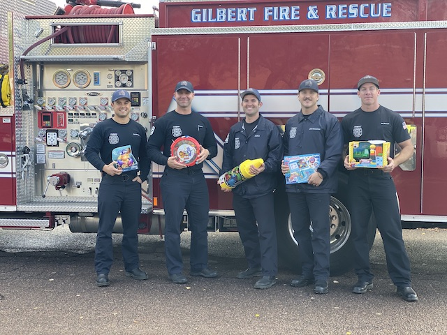 Firefighters with toys